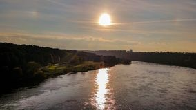 Rising sun in the river in the city Stock Photos