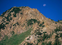 Rising sun, setting moon, Pioneer Peak in Little Cottonwood Canyon, Wasatch Range, Utah stock images