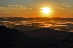 Sea of clouds at sunrise in the mountains royalty free stock image