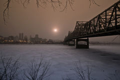 Rising Sun In Winter, Peoria Illinois USA. Murray Baker Bridge in winter at dawn, Peoria Illinois USA Royalty Free Stock Photography