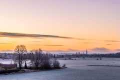 Rising. Sunrise view of the cathedral and castle of Uppsala from Gamla Uppsala, Sweden royalty free stock photos