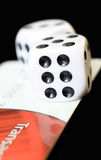 Risk. Two dices on a electronic bank card royalty free stock photo