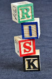Risk. Building blocks isolated on black, with the word risk Royalty Free Stock Photo