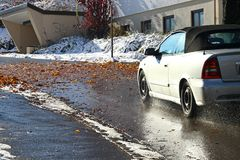 Risk of accident due to wet leaves and snow in road traffic Stock Photos