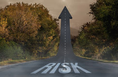 Risk against road turning into arrow Stock Photo