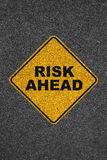 Risk ahead road sign on above asphalt texture Stock Image