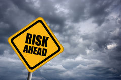 Risk ahead sign. Diamond shaped risk ahead illustrated sign Royalty Free Stock Photo