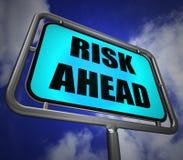 Risk Ahead Signpost Shows Dangerous Unstable and Insecure Warnin. Risk Ahead Signpost Showing Dangerous Unstable and Insecure Warning Stock Photo