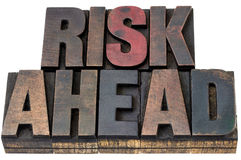 Risk ahead in woo dtype. Risk ahead - isolated words in vintage letterpress wood type with ink patina Stock Photography