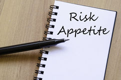 Risk appetite write on notebook. Risk appetite text concept write on notebook with pen Royalty Free Stock Photography