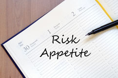 Risk appetite write on notebook. Risk appetite text concept write on notebook with pen Stock Photo
