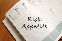 Risk appetite write on notebook. Risk appetite text concept write on notebook with pen Royalty Free Stock Images