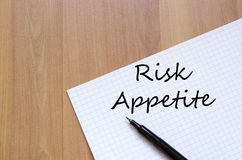 Risk appetite write on notebook. Risk appetite text concept write on notebook with pen Stock Images