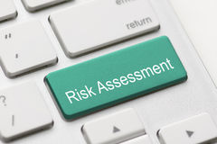 Risk assess assessment project market keyboard button. Keypad caution issue critical solving concept - stock image Royalty Free Stock Photography