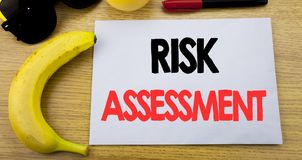 Risk Assessment. Business concept for Safety Danger Analyze written on sticky note empty paper, wooden background with copy space,. Risk Assessment. Business Stock Photo