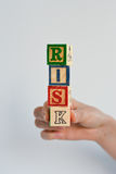 Risk assessment. Or management plan with colorful wooden letter cubes royalty free stock photography