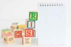 Risk assessment or management plan. With notebook and wooden cubes Stock Image