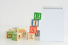 Risk assessment or management plan. With notebook and wooden cubes Royalty Free Stock Photos