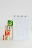 Risk assessment or management plan. With notebook and wooden letter cubes Stock Images