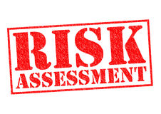 RISK ASSESSMENT. Red Rubber Stamp over a white background Stock Photography