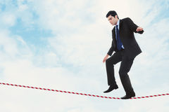 Risk in Business. Stock image of businessman walking the tightrope Royalty Free Stock Image