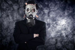 Risk concept, businessman with gas mask and black suit. Art royalty free stock photography