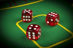 risk concept - playing dice on a green gaming table. Playing a game with dice. Red casino dice rolls. Rolling the dice concept royalty free stock images