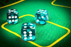 risk concept - playing dice on a green gaming table. Playing a game with dice. Blue casino dice rolls. Rolling the dice concept fo Royalty Free Stock Photo
