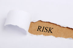 Risk Concept. Torn Paper with headline word Risk royalty free stock photo