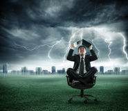 Risk and crisis - businessman is repaired by storm. With computer Stock Images