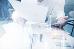Risk Department Work Online Process.Photo Trader working Market Report Documents Touching Screen Tablet.Using Graphics. Stock Exchanges Reports,Digital Royalty Free Stock Photos