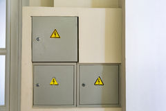 Risk of electric shock. The triangular yellow sign of the danger of electric shock stock photos