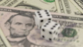 Risk factor on dollar investments dices on banknotes rotating stock footage