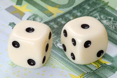 Risk factor on euro investments. Dices on euro banknotes, simulating risk on investments on euro Stock Images