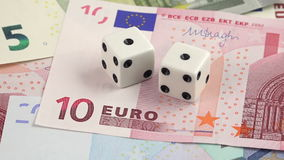 Risk factor on european investments dices on banknotes rotating stock video
