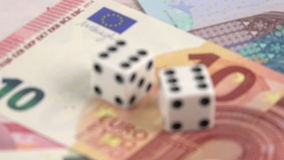 Risk factor on european investments dices on banknotes rotating stock video footage