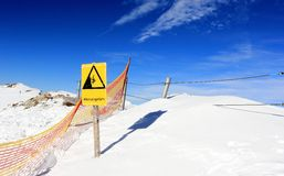 Risk of falling! The Nebelhorn Mountain in winter. Alps, Germany. Stock Image