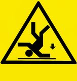 Risk of falling, warning sign with the silhouette of a man upside down and an arrow pointing down stock illustration