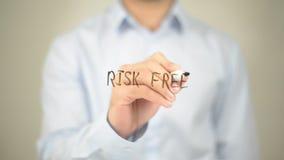 Risk Free, Man Writing on Transparent Screen royalty free stock photos