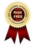 Risk free satisfaction guaranteed. 100% customer satisfaction guaranteed golden seal with risk free text on center,  red / maroon color shiny ribbons Stock Photography