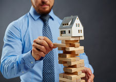 Risk in housing business Stock Image