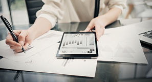 Risk investment manager working process.Closeup photo business woman showing reports modern tablet screen.Statistics Royalty Free Stock Photos