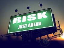 Risk Just Ahead on Green Billboard. Stock Image