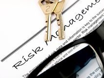 Risk management. Document and keys for visualizing risk management. Close up on white background stock photo