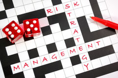 Risk management. Crossword with dice and the words risk management strategy royalty free stock image