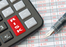 Risk management. Enter key of a calculator entitled risk with data sheet royalty free stock photos