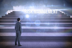 Risk management against steps against blue sky Royalty Free Stock Image