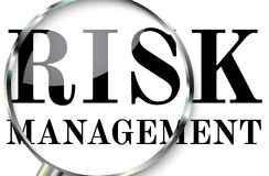 Risk management in focus. Magnifying glass focusing on risk and risk management Stock Photography