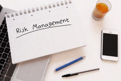 Risk Management. Handwritten text in a notebook on a desk - 3d render illustration Royalty Free Stock Photos