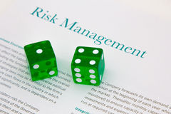 Risk Management. Image with a risk report with dices to depict risk management Royalty Free Stock Photo
